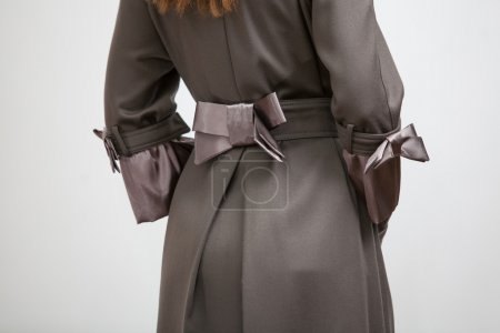 Back of the women coat with silk bow