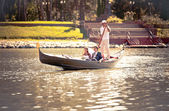 Married couple riding on gondola on river