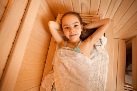 Photo for Closeup portrait of little girl lying at sauna - Royalty Free Image