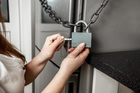 photo of image hanging lock on refrigerator