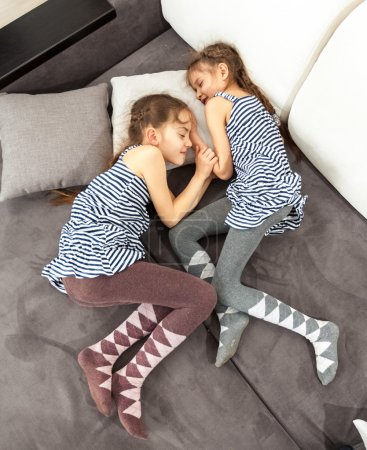 Photo for Photo of two twin girls sleeping on couch - Royalty Free Image
