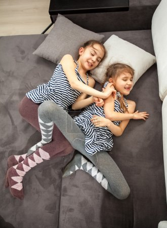 young sisters fighting on bed