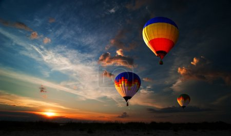 Photo for Colorful hot air balloon is flying at sunrise - Royalty Free Image