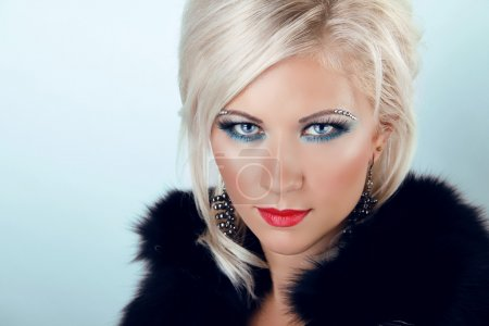 Photo for Fashion blond woman with blue eyes and red lips, wearing in fur coar - Royalty Free Image