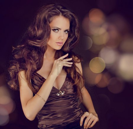 Photo for Fashion lady, sensual brunette woman with shiny curly silky hair in elegant dress - Royalty Free Image