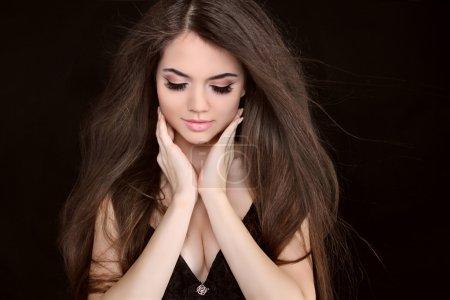 Beautiful woman with long brown hair. Closeup portrait of fashi