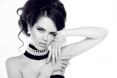 Fashion portrait of beautiful woman with pearls, black and white