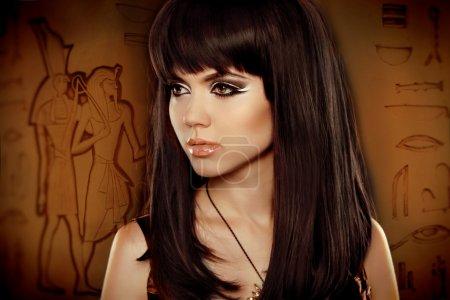 Hair. Beautiful Brunette Girl over Egyptian hierog...