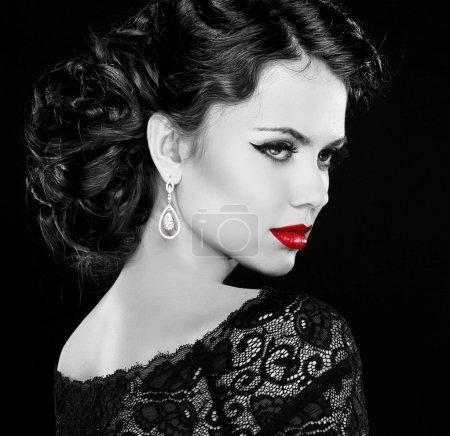 Photo for Retro woman. Fashion model girl portrait. Black and white photo. Isolated on black background. - Royalty Free Image