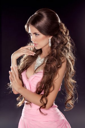 Hairstyle. Long wavy hair. Fashion photo of young woman. Sexy Gi
