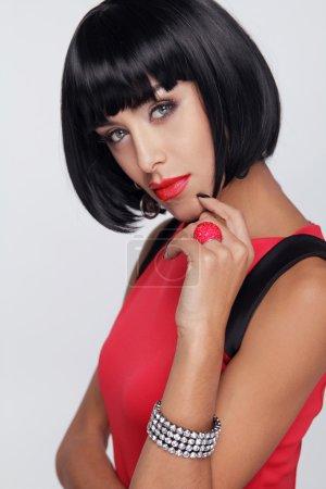 Sexy beauty brunette woman. Makeup. Stylish Fringe. Black Short
