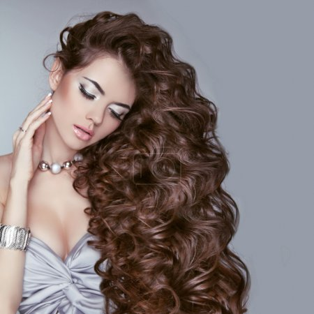 Hair. Beauty Woman with Very Long Healthy Brown Curly Hair. Mode