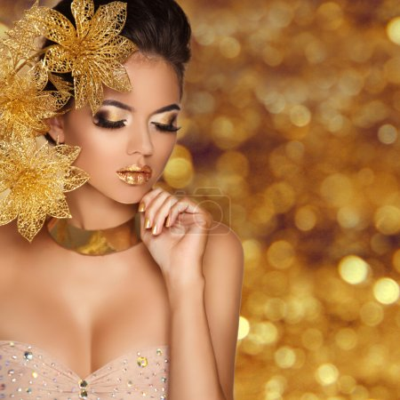 Photo for Fashion Beauty Girl portrait with flowers Isolated on golden bokeh lights Background. Glamour Makeup. Gold Jewelry. Hairstyle. Luxury photo - Royalty Free Image