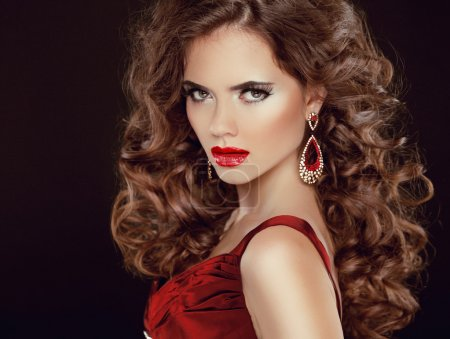 Photo for Red sexy lips. Stare. Beauty Brunette Girl Model with luxurious wavy long hair isolated on dark background - Royalty Free Image