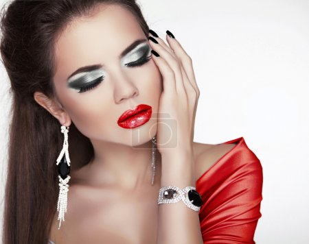 Portrait of the beautiful sexy woman with makeup, red lips and j