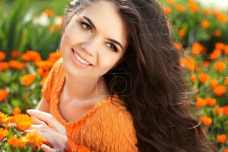 Beauty woman portrait with flowers. Free Happy Brunette Enjoying