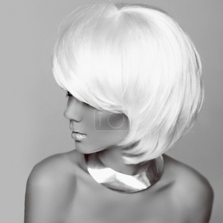 Hairstyle. Fashion blonde woman. White Short Hair. Beautiful gi