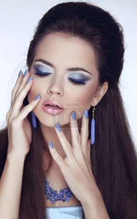 Manicured nails. Makeup. Glamour Fashion Beauty Woman Portrait.