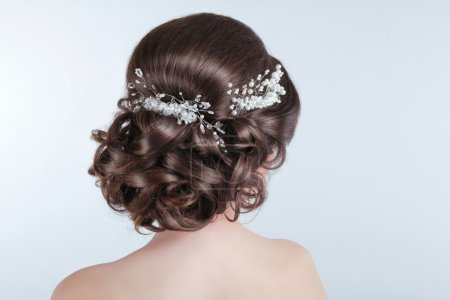 Beauty wedding hairstyle. Bride. Brunette girl with curly hair s