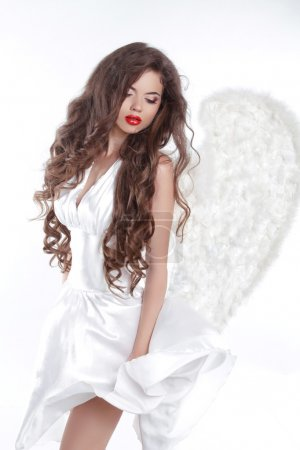 Long wavy Hair. Model Angel Girl in blowing dress with white win
