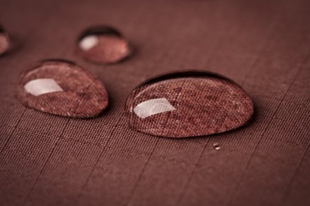 Water drops to waterproof fabric...