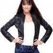 Glamorous young woman in black leather jacket on w...