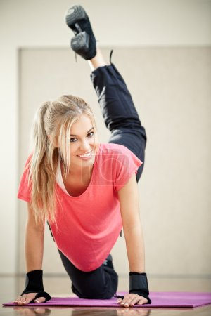 Photo for Smiling female fitness instructor in a gym - Royalty Free Image