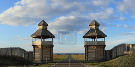 Old style wooden gate with towers