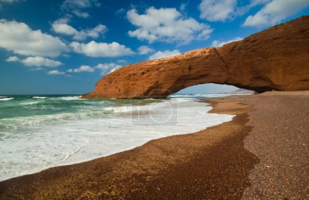 Natural arch on the beach Legzira. Morocco