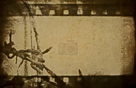 Concept old grunge film strip and barbed wire background