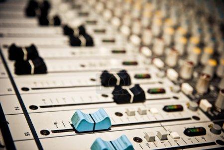 Music mixer in studio closeup...