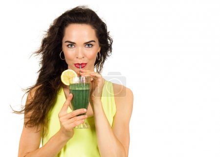 Photo for Beautiful healthy woman drinking an organic green smoothie. Isolated on white. - Royalty Free Image