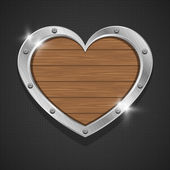 Shiny wooden heart bubbles in aluminum edging on metal background