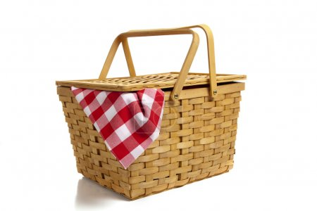 Photo for A wicker picnic basket with a red gingham cloth on a white background - Royalty Free Image