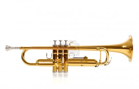 A brass colored trumpet on white background with c...