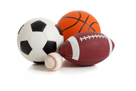 Photo for Assorted sports ball on a white background. Includes a soccer ball, a football, a basketball and a baseball - Royalty Free Image