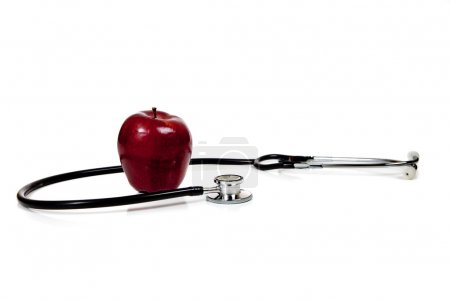 Stethoscope with apple on a white background