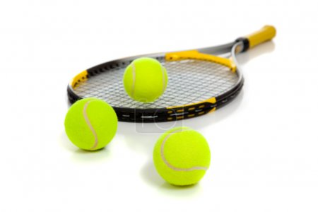 Tennis raquet with yellow balls on white