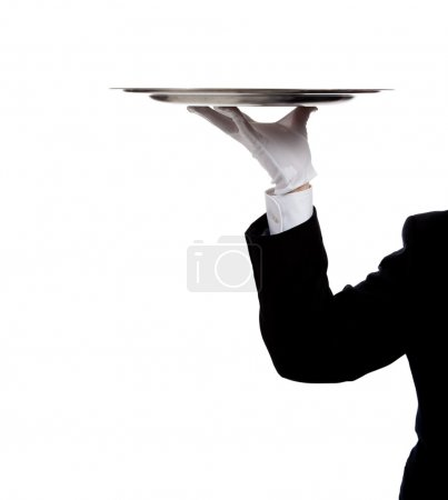 Photo for A butler's gloved hand holding a silver tray on a white background with copy space - Royalty Free Image