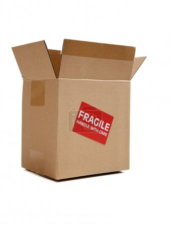 Brown cardboard moving box on a white background w...