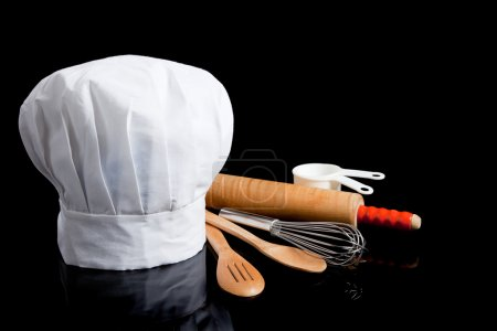 Toque with cooking utensils