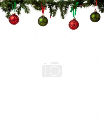 Photo for A christmas ornament border with red and green glittered baubles hanging from garland with red and green ribbon - Royalty Free Image
