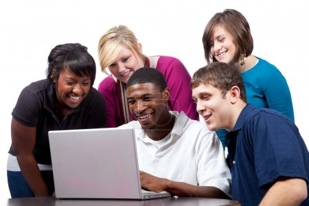 Multi-racial college students sitting around a computer