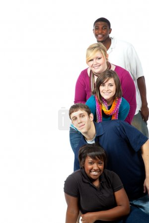 Photo for A stack of multi-racial college student on a white background with copy space - Royalty Free Image