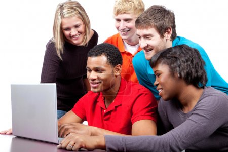 Photo for A group of multi-racial college students sitting around a computer - Royalty Free Image