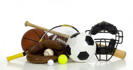 Photo for A variety of sports gear on a white background including tennis racket and ball, a soocer or football, an american football, a baseball bat, glove and catcher's mask - Royalty Free Image