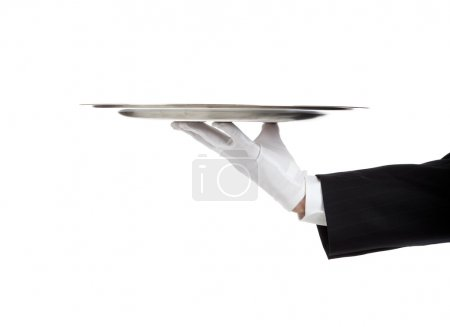 Photo for A white gloved hand holding a silver tray - Royalty Free Image