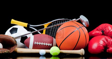 Photo for Assorted sports equipment including a basketball, soccer ball, tennis ball, golf ball, bat tennis racket, boxing gloves, football, golf and baseball glove - Royalty Free Image