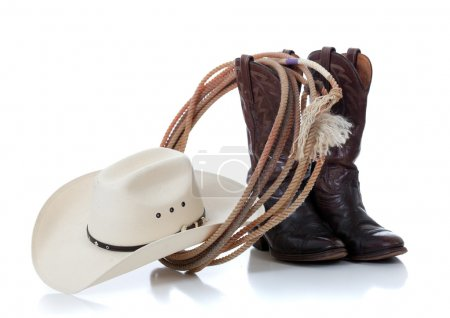 Photo for A white cowboy hat, brown leather boots and lariat on a white background - Royalty Free Image
