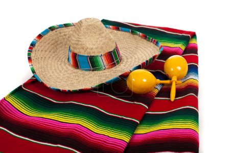 Photo for Mexican Serape, sombrero and yellow maracas on a white background - Royalty Free Image